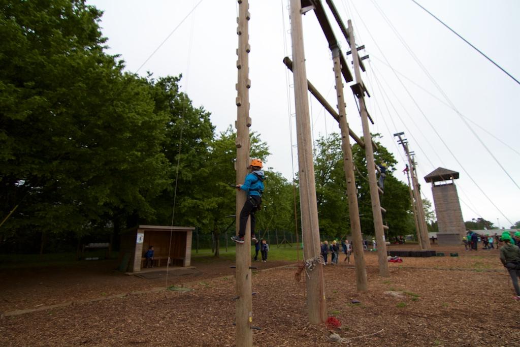 boy climbing equilibrium tower