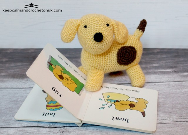 Spot the Dog amigurumi with his paw on a Spot the Dog book.