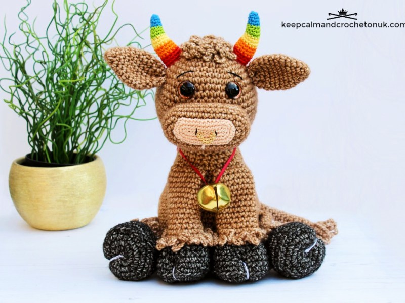 Image of a cute amigurumi crochet ox with rainbow horns