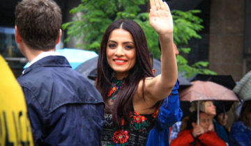 Celina Jaitly and Cyndi Lauper led the Toronto Pride Parade 2015 despite constant drizzle and cold temperature.