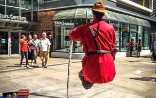RCMP Officer Floating Busker in Toronto.