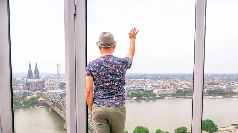 Man standing on KolnSky Observation deck