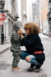 mother adjusting little boys jacket