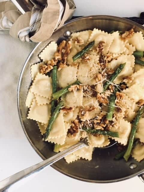 Cheese Ravioli in brown butter with Walnuts Asparagus
