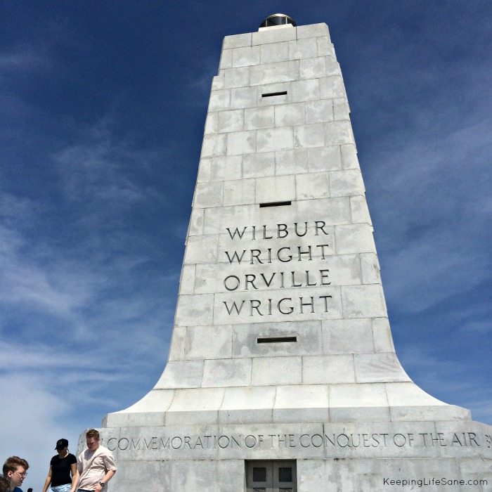 Monument at the Wright Brothers Memorial. Tall and White whith blue sky
