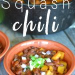 Bowl of butternut squash chili with sour cream and green onions