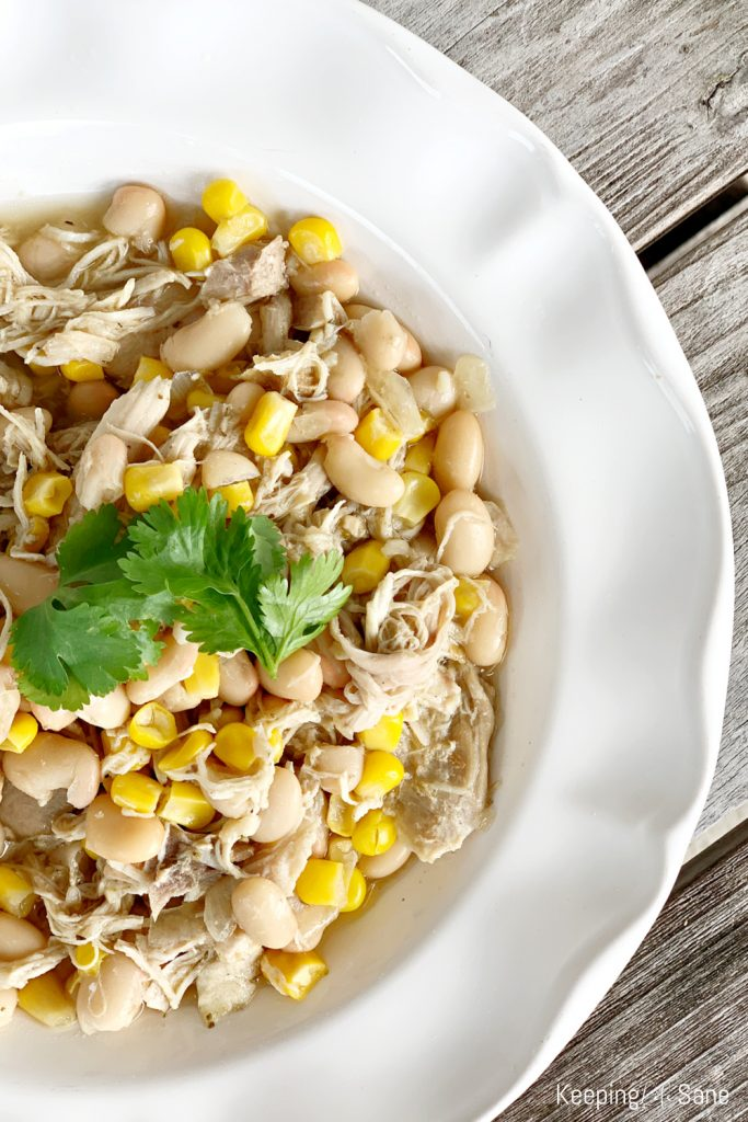 close up of white bowl with white chicken chili
