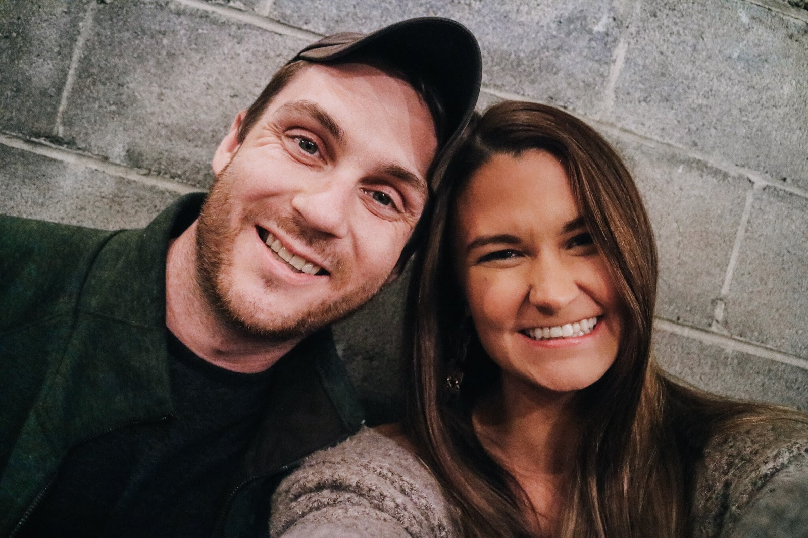 Travel blogger and her husband selfieing on the outside patio at District in New Orleans