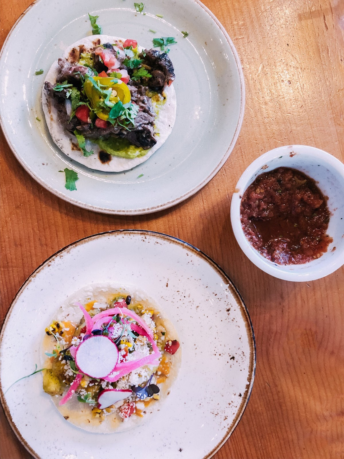 Carne asada taco and cauliflower taco at Johnny Sánchez in New Orleans