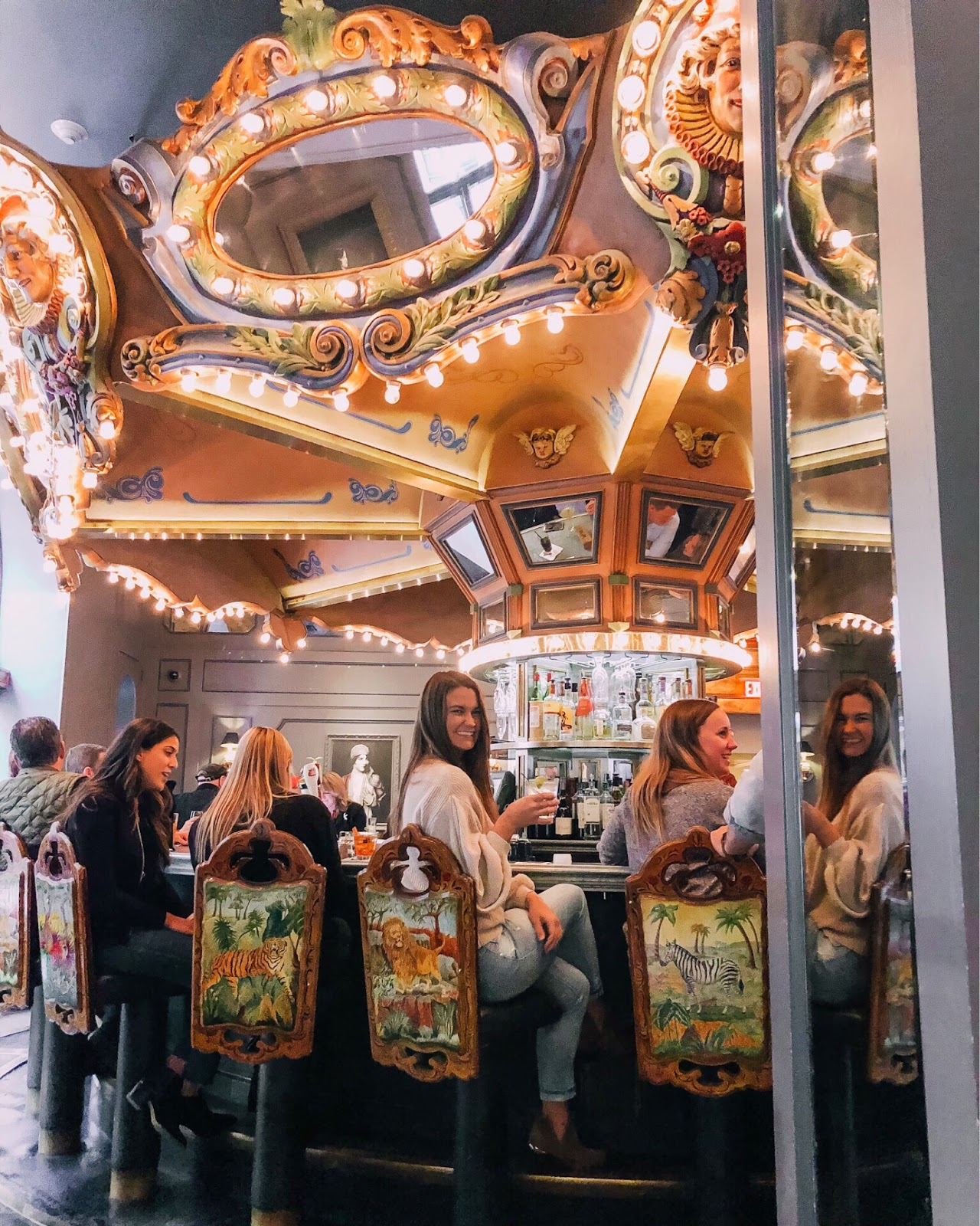 Travel blogger posing at The Carousel Bar located inside of the Hotel Monteleone in New Orleans
