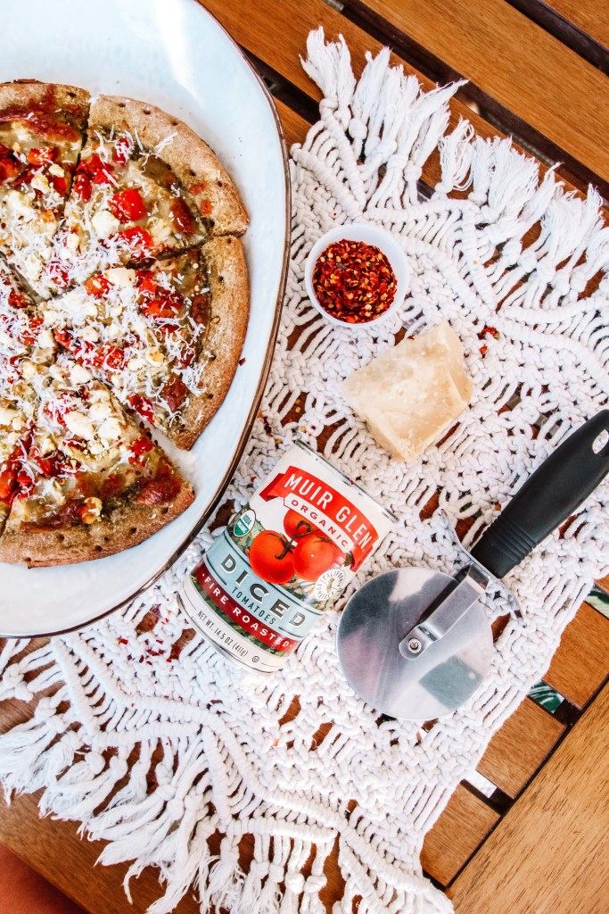 Sharing my Chicken Pesto Pizza with Feta and Muir Glen Fire Roasted Tomatoes. Perfect for a date night in or for a night with friends!