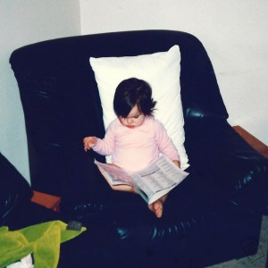 Baby bookworm Sheree reading on couch - Keeping Up With The Penguins