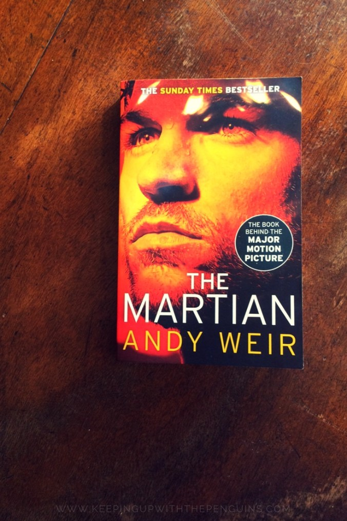 The Martian - Andy Weir - book laid on wooden table - Keeping Up With The Penguins