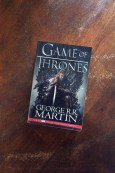 A Game of Thrones - George R R Martin - Book Laid On Wooden Table - Keeping Up With The Penguins