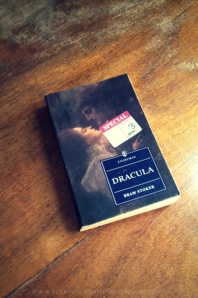 Dracula - Bram Stoker - book laid on wooden table - Keeping Up With The Penguins