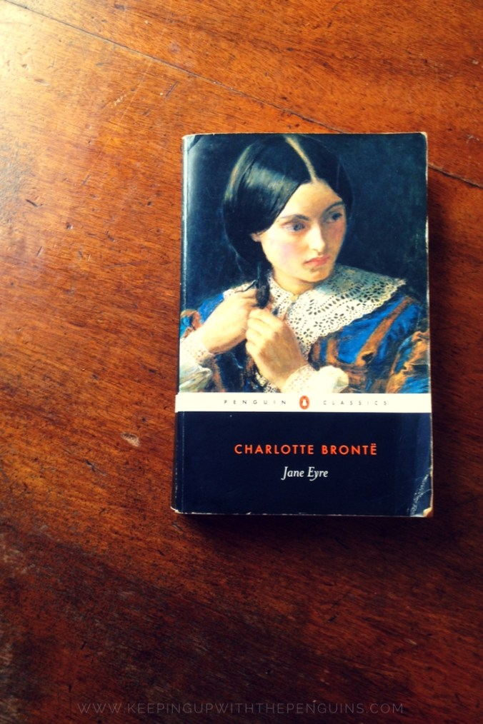 Jane Eyre - Charlotte Bronte - book laid on a wooden table - Keeping Up With The Penguins