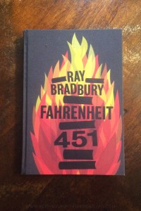Fahrenheit 451 - Ray Bradbury - Book Laid on Wooden Table - Keeping Up With The Penguins