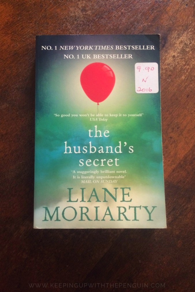 The Husband's Secret - Liane Moriarty - Book Laid on Wooden Table - Keeping Up With The Penguins
