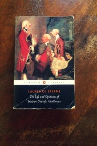 The Life And Opinions of Tristram Shandy, Gentleman - Laurence Sterne - Book Laid on Wooden Table - Keeping Up With The Penguins