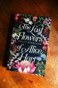 The Lost Flowers of Alice Hart - Holly Ringland - Book Laid on Wooden Table - Keeping Up With The Penguins