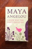 I Know Why The Caged Bird Sings - Maya Angelou - Book Laid on Wooden Table - Keeping Up With The Penguins