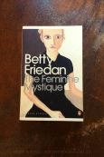 The Feminine Mystique - Betty Friedan - Book Laid on Wooden Table - Keeping Up With The Penguins