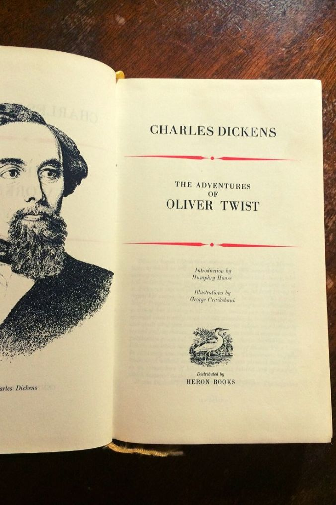 Oliver Twist - Charles Dickens - Book Laid Open On Wooden Table - Keeping Up With The Penguins