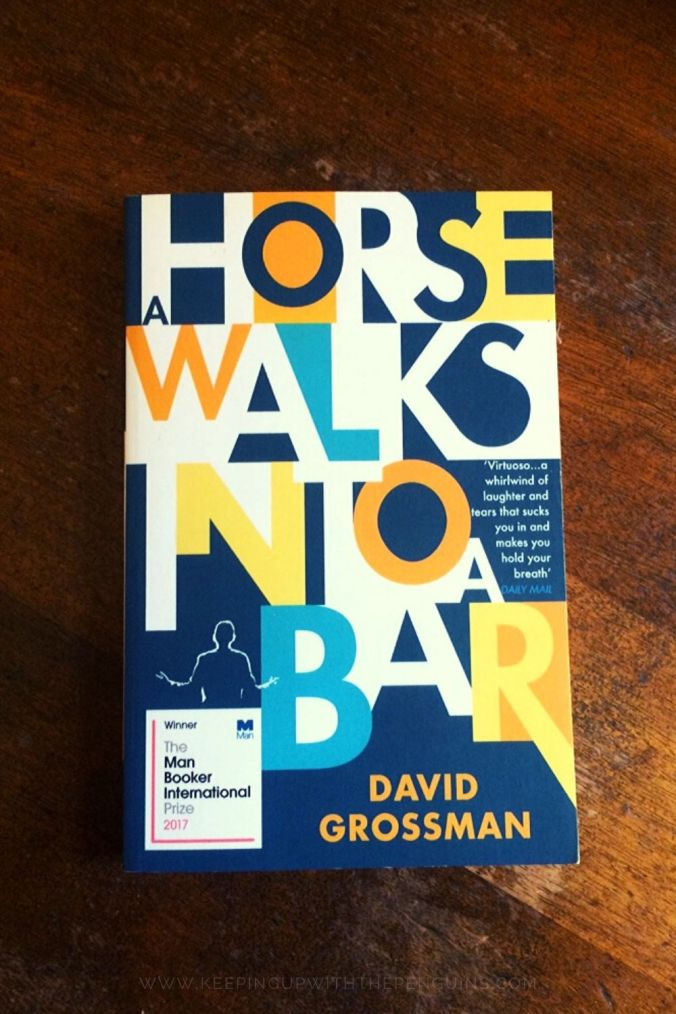 A Horse Walks Into A Bar - David Grossman - Book Laid on Wooden Table - Keeping Up With The Penguins