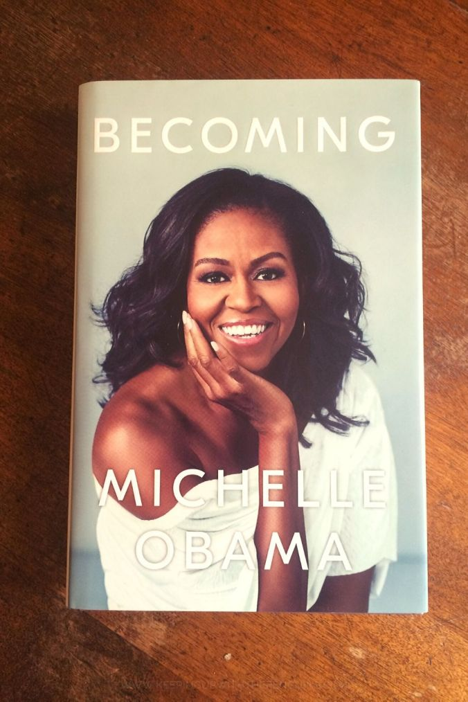 Becoming - Michelle Obama - Book Laid Face Up On Wooden Table - Keeping Up With The Penguins