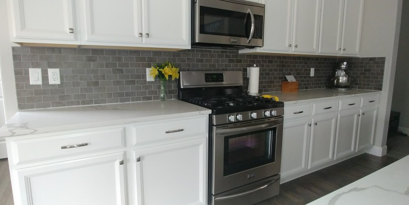 Kitchen after picture with backsplash