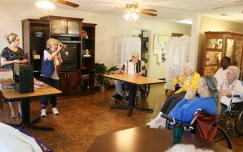 Bobette Heaton gives a soil demonstration at the Madisonville Care Center