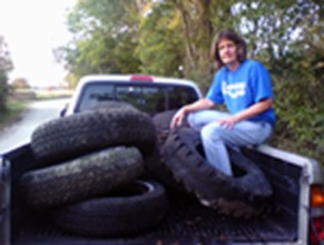 Kay Welch with tires to be recycled