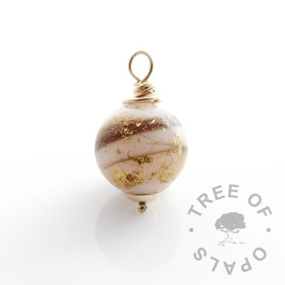 breastmilk and first curl pearl with gold leaf set with gold wire wrapped bezel, fully drilled and wrapped by hand.