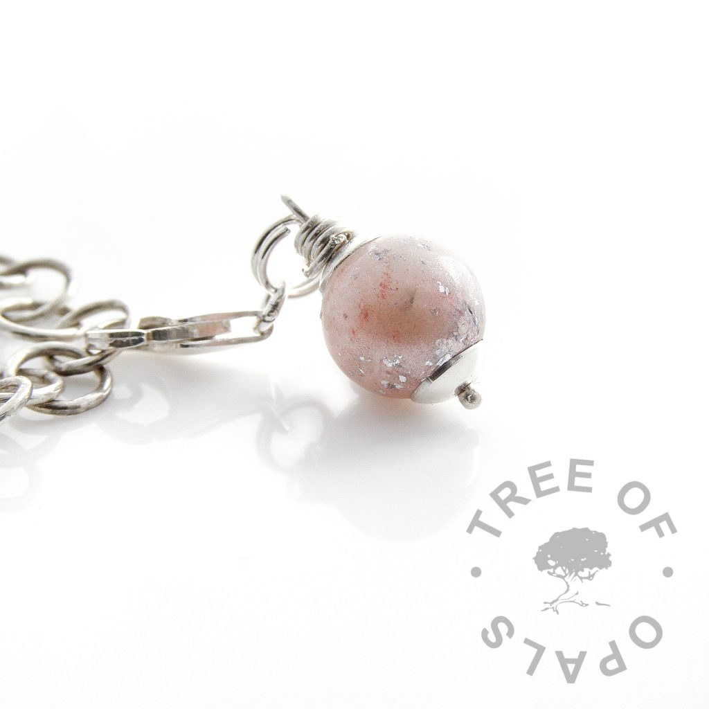 breastmilk pearl with pink shimmer and silver leaf, fully drilled and wire wrapped by hand with sterling silver head pin. Lobster clasp setting