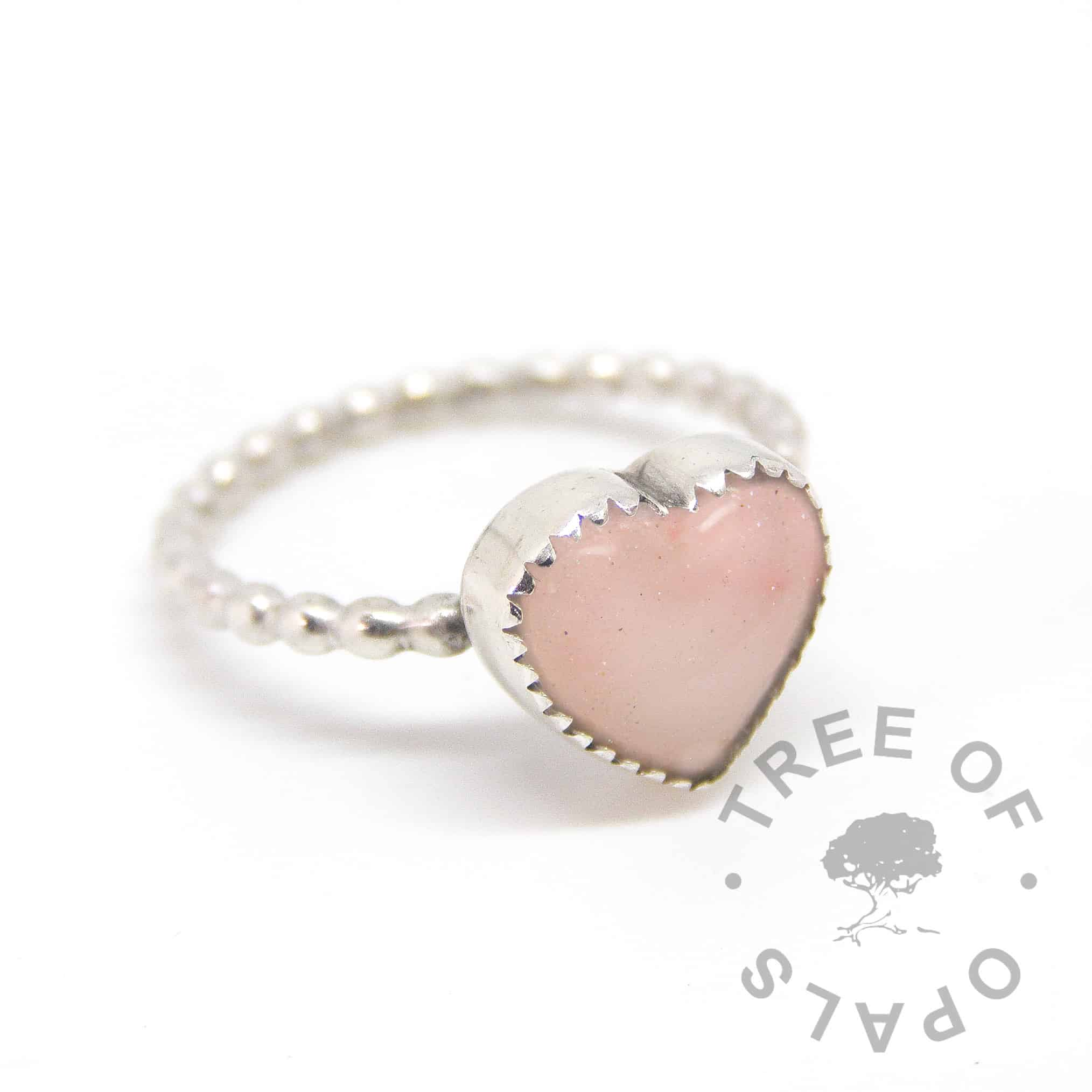 breastmilk heart ring with 10mm medium heart cabochon made with milk powder, pink mica blend and diamond powder