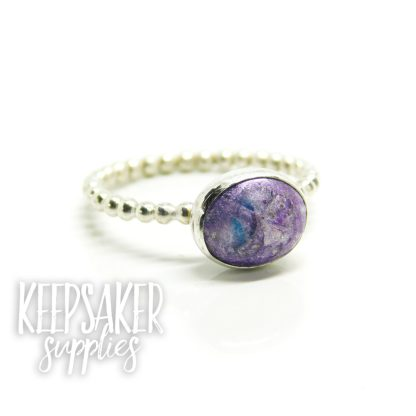 purple blue ring, orchid purple and Aegean blue resin sparkle mixes swirled together with cremation ashes, on bubble wire band