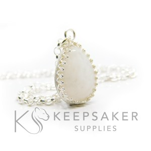 Classic breastmilk teardrop necklace. Crown point teardrop Classic breastmilk teardrop necklace. Crown point teardrop setting in solid sterling silver, 925 stamped. Shown with a medium classic chain (not included)setting in solid sterling silver, 925 stamped. Shown with a medium classic chain (not included)