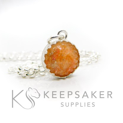 Orange ashes small round necklace. Crown point small round setting in solid sterling silver, 925 stamped. Tangerine orange resin sparkle mix. Shown with a medium classic chain (not included)