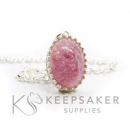 Pink ashes oval necklace. Crown point oval setting in solid sterling silver, 925 stamped. Fairy pink resin sparkle mix. Shown with a medium classic chain (not included)