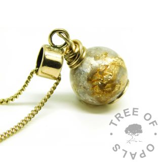 solid gold ashes pearl with 9ct gold European setting, shown on a medium-heavy 9ct yellow gold chain upgrade. Unicorn white resin sparkle mix and lots of gold-filled leaf with cremation ashes in resin. Compatible with Chamilia and Pandora bracelets
