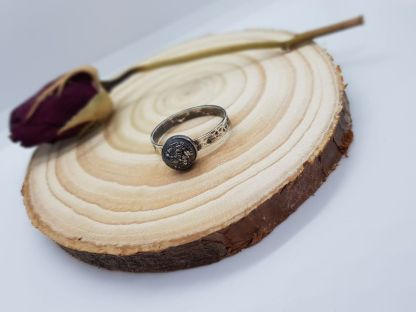 gothic ring hammered antique ashes, photo credit Leanne Murdie - cremation ashes and black in an 8mm cabochon, unset