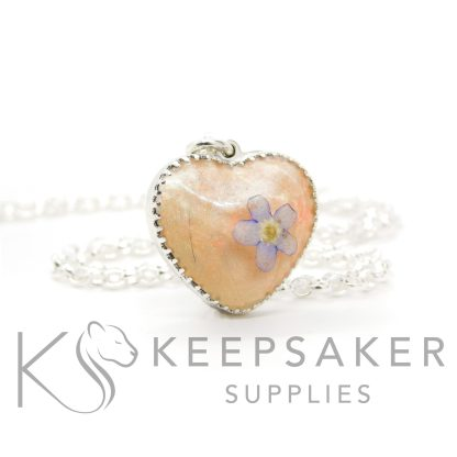 """New style heart necklace setting with scalloped edge. Fairy pink resin sparkle mix, lock of hair, shaped forget me not, shown with a medium classic chain upgrade (mockup of new setting). Remember that """"white hair"""" is often translucent in resin!"""