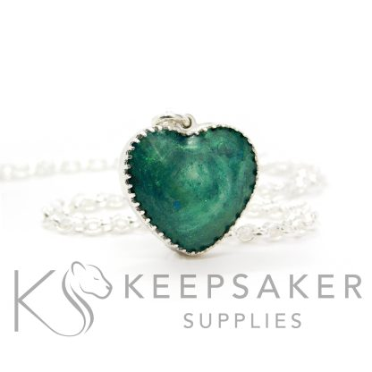 """New style heart necklace setting with scalloped edge. Mermaid teal resin sparkle mix, lock of hair, shown with a medium classic chain upgrade (mockup of new setting). Remember that """"white hair"""" is often translucent in resin!"""