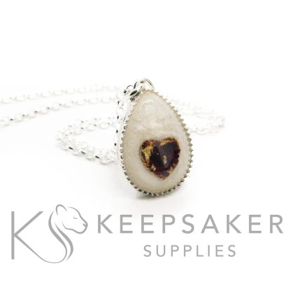 breastmilk teardrop necklace with umbilical cord heart. Nikki's own! Shown with a necklace chain. 935 high quality solid silver. Exclusive scalloped settings from Keepsaker Supplies in anti-tarnish silver breastmilk jewellery