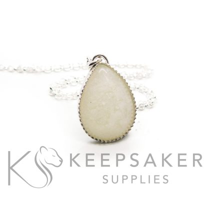 breastmilk teardrop necklace shown with a necklace chain. 935 high quality solid silver. Exclusive scalloped settings from Keepsaker Supplies in anti-tarnish silver breastmilk jewellery