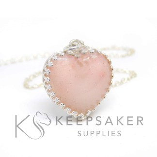 Breastmilk heart with fairy pink sparkle mix and diamond powder for two year breastfeeding award or April birthstone. Crown heart necklace in shiny silver