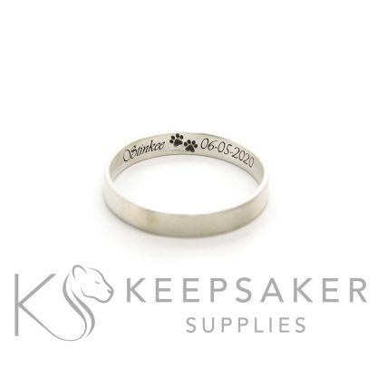 Brushed band stacking ring with vivaldi font engraving inside the band with paw print emojis