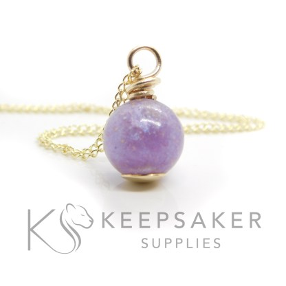 Solid gold set cremation ashes orb with purple sparkle mix and wire wrapped setting. Chain upgrade