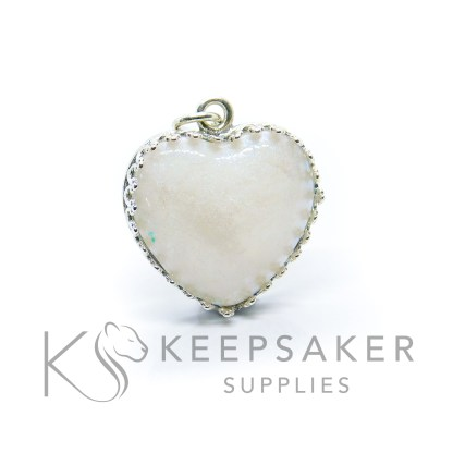 pearly blue breastmilk heart necklace, 18mm crown point sterling silver heart setting with breastmilk and resin heart. Subtle pearly blue breastmilk resin sparkle mix. Shown without chain