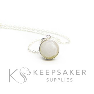 small breastmilk necklace, 8mm glue-in setting with breastmilk cabochon. Shown with a delicate chain